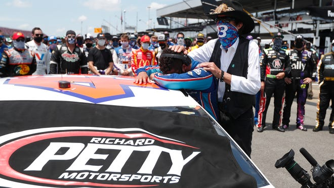 Driver Bubba Wallace, left, is overcome with emotion as team owner Richard Petty, comforts him as he arrives at his car in the pits of the Talladega Superspeedway prior to the start of the NASCAR Cup Series auto race at the Talladega Superspeedway in Talladega Ala., Monday June 22, 2020. In an extraordinary act of solidarity with NASCAR's only Black driver, dozens of drivers pushed the car belonging to Bubba Wallace to the front of the field before Monday's race as FBI agents nearby tried to find out who left a noose in his garage stall over the weekend.