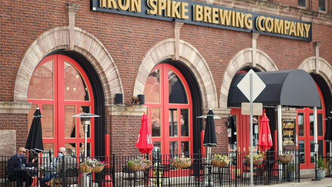 A trio of diners enjoy their lunch in the outside seating area at Iron Spike Brewing Company, 150 E. Simmons St., on Ocf. 1, 2020.