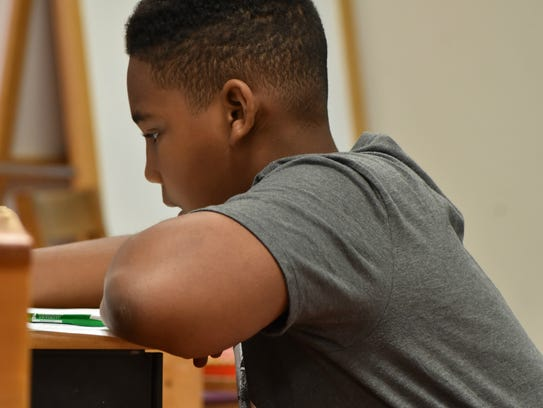Brandon Jones, 11, works on a math problem at Wilmington