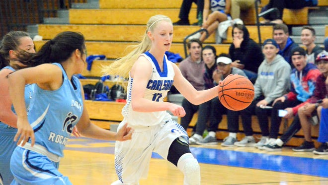 Carlsbad's Carsyn Boswell bolts toward the basket in the first quarter Tuesday.