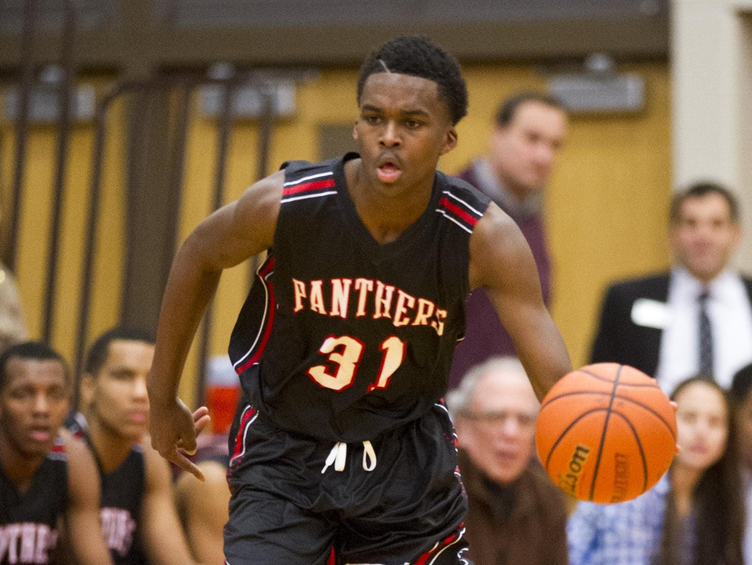 North Central's Kris Wilkes brings the ball upcourt Jan. 13 at the county tourney.