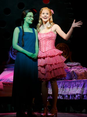 "Alyssa Fox (left) as Elphaba and Carrie St. Louis as Glinda in the national tour of ""Wicked."""