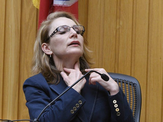 Knox County Medical Examiner Dr. Darinka Mileusnic-Polchan demonstrates the position of the stab wounds on Brittany Eldridge's neck during the first day of testimony in the second murder trial for Norman Eugene Clark, Tuesday, Sep. 12, 2017. Clark is accused, in Knox County Criminal Court before Judge Steven Sword, of killing his girlfriend, Brittany Eldridge, and their unborn son in December 2011.
