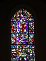 One of dozens of large-scale stained glass windows