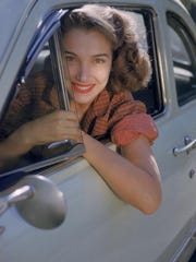 Portrait of American actress Julie Adams as she leans out of the window of a car, early 1950s. (Photo by Ruth Orkin/Getty Images)