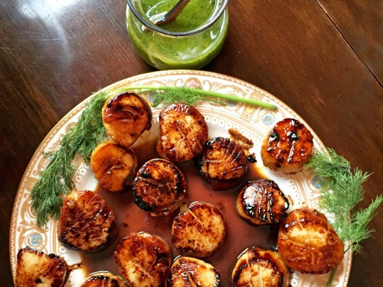 Embrace at least two food trends for 2018 by serving sustainable scallops with chimichurri sauce.