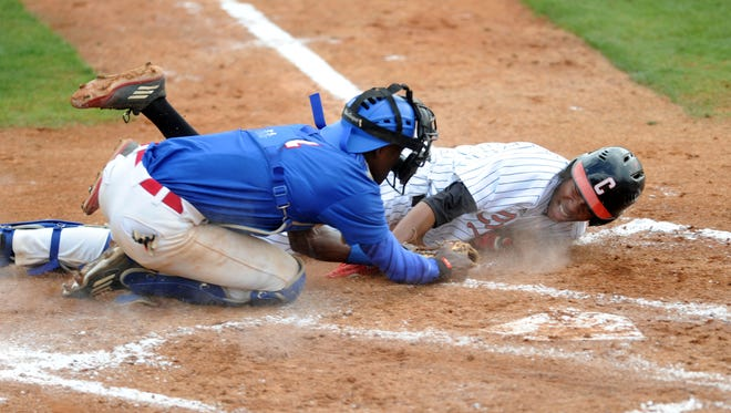 William Carey Tyler James slides into home plate Tuesday in a game against Tougaloo College at Milton Wheeler Field.