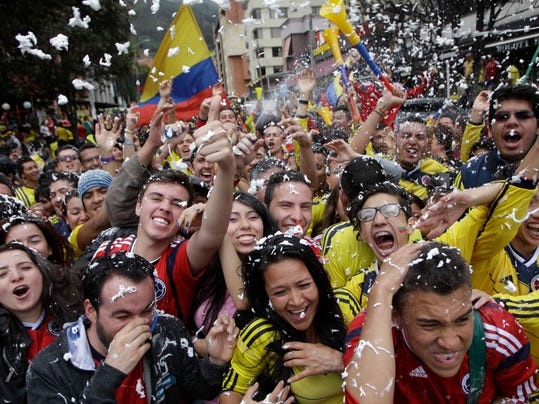 Colombia soccer fans cheer after their team's World Cup victory over Ivory Coast in Bogota, Colombia, Thursday, June 19, 2014. Colombia won 2-1. (AP Photo/Javier Galeano)