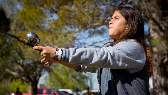 11-year-old Juliett Ramirez practices fly casting during a Kids Fishing Clinic sponsored by the Mesilla Valley Flyfishers group and the New Mexico Department of Game & Fish at the NMSU Alumni Pond, April 2, 2016.