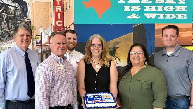 Brown County United Way board members surprised Karen Lynch, who resigned recently as the United Way's executive director, with a cake and presented it to her at United Supermarkets. Lynch, who served as the agency's director for 15 years, resigned because of her husband's job reassignment. Pictured with Lynch are Mike Rodgers, Lynn Day, Brandon Price, United; Karen; Connie Madrid and Jeff Mitchell.