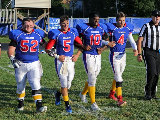 Reading team captains are, from left, Andy Combs, Marcus