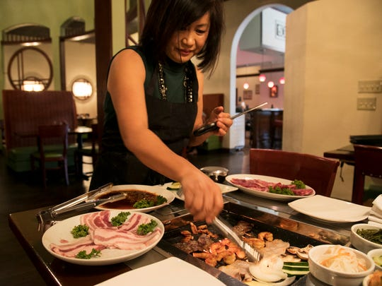 Origami owner Rosa Kim cooks Korean barbecue on Thursday, Feb. 16, 2018. The cooked short ribs, shrimp and pork belly are then put into a lettuce wrap with rice and bean paste.