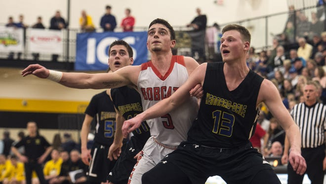 Kennard-Dale's Adam Freese (13) and Northeastern's Antonio Rizzuto anticipate rebound, Tuesday, Feb. 12, 2018. The Northeastern Bobcats beat the Kennard-Dale Rams, 58-44, advancing to the YAIAA championships.
