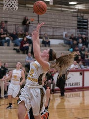Taylor Webster puts up a shot against the Tigers in