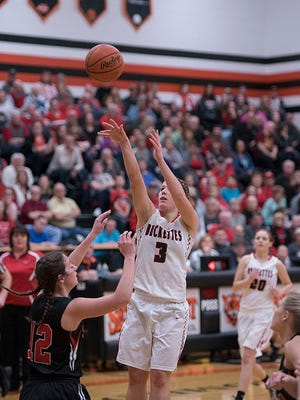 Jenna Karl puts up a shot against Norwalk St. Paul in the district final, a game where she led the team in scoring with 25 points, hauling in 11 rebounds in the process.