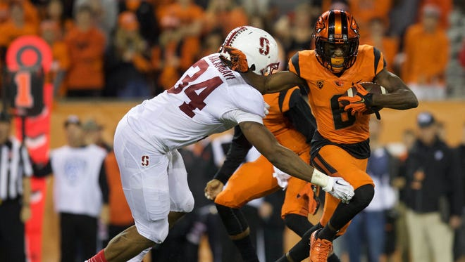 Sep 25, 2015; Corvallis, OR, USA; Oregon State Beavers wide receiver Victor Bolden (6) breaks a tackle from Stanford Cardinal linebacker Peter Kalambayi (34) at Reser Stadium. Mandatory Credit: Scott Olmos-USA TODAY Sports