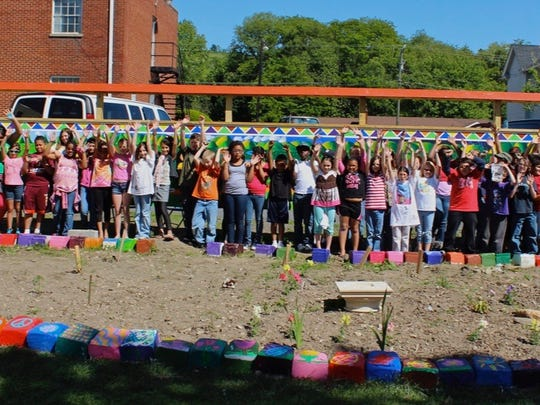 In May 2012, Mary Baldwin University students worked with children from Wenonah Elementary School in Waynesboro to create a mural. The mural creation is part of the class Permeable Borders taught by Spencer Center Artist-in-Residence Claudia Bernardi.