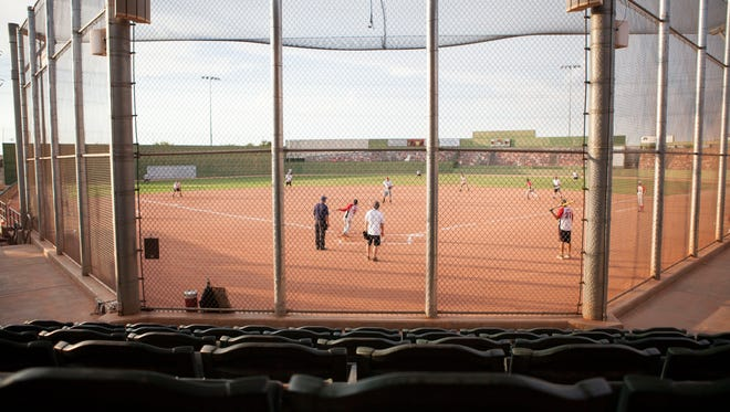 Gilbert is suing to have repairs completed or paid for by the M.A. Mortenson Co., which built the complex that opened in 2008.