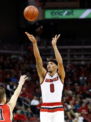 Louisville's Damion Lee knocks down a 3-pointer in the first half over the outstretched arm of Hartford's Jason Dunne. Nov. 17, 2015