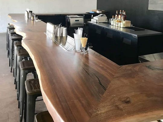 The bar crafted by Kokopelli Custom Woodworks in the Old Walrus cocktail lounge at Arizona Distilling Co. in Tempe.
