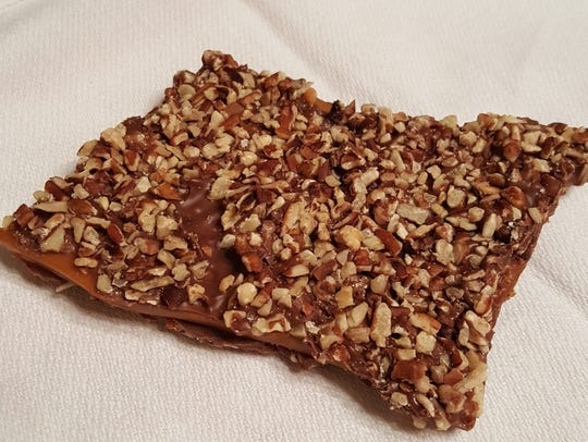 A quarter pound of toffee ($3.25 each) is offered at The Chocolate Lady. The English style toffee is coated in milk chocolate and finely chopped pecans.