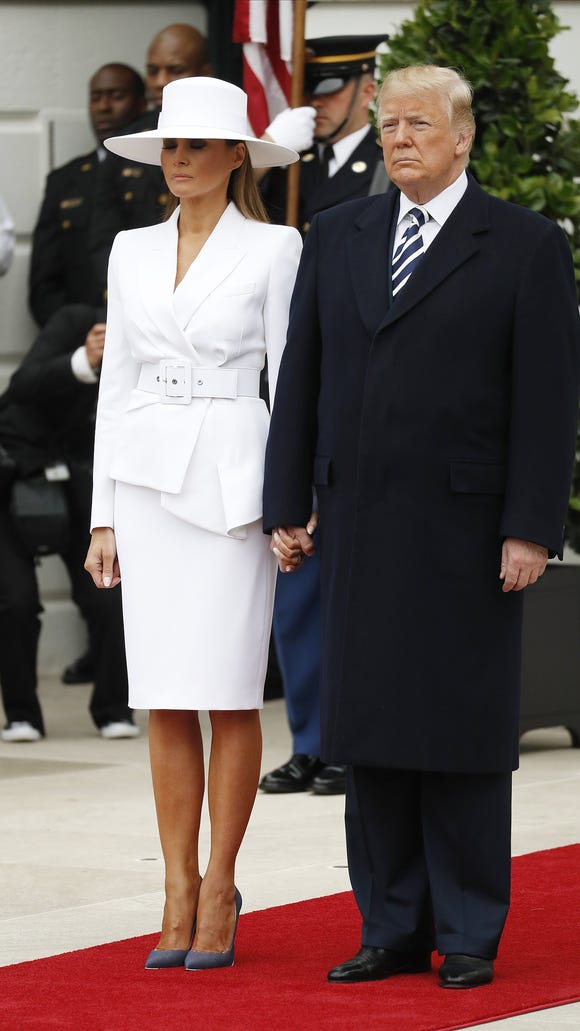 The first couple awaiting French President Emmanuel