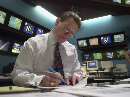 Pete Giddings pores over weather data in the KOLO 8 studio in 2000.