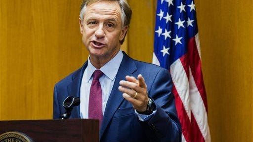 Gov. Bill Haslam speaks to reporters in a February file photo.