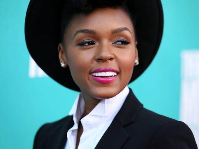 Move aside, Justin Timberlake. No one can rock a suit and tie quite like Janelle Monae. As the 27-year-old soul singer gets ready to release her sophomore album 'The Electric Lady' on Tuesday, let's look back at some of her swankiest and funkiest spins on the classic tuxedo.