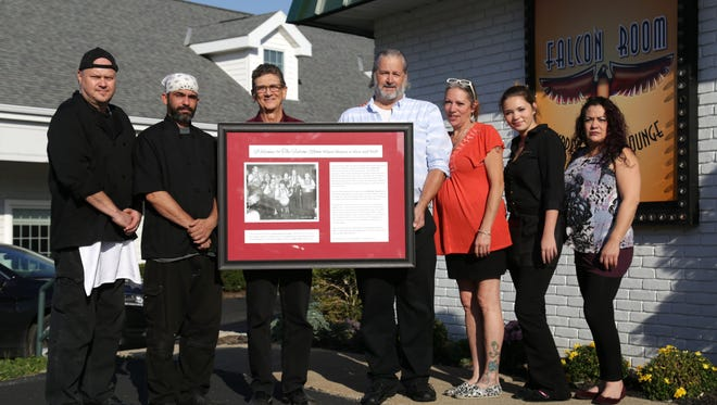 The leader of the Rib Ticklers, Ralph Thauvette (second from the left), stands with the staff of the Falcon Room: Jeff DeWeese (left to right), Brad Peasce, Dave Rhinehart, Shelli Street, Lucy Croyle and Donna Tooman. The band started in 1966 in the restaurant, which at that time was known as the Adam's Rib Restaurant and Lounge.