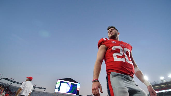 Ole Miss QB Shea Patterson (20) walks off the field after the game against the Vanderbilt Commodores at Vaught-Hemingway Stadium.