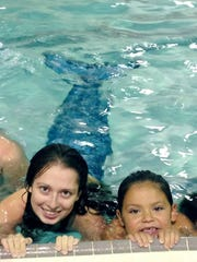 Mermaid Alexis Vanaman (left) and Joelia Soto share the pool at Holly City Family Center in Millville. The center just started offering pool parties with kid-friendly themses such as mermaids, pirates and superheroes.