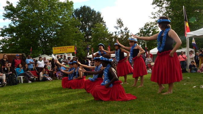 Paradise of Samoa dance troupe, which performed at the World Beat Festival, will perform for the Kids' Late Night at the Salem Public Library, a party for those kids who were faithful to their unplugged pledge.