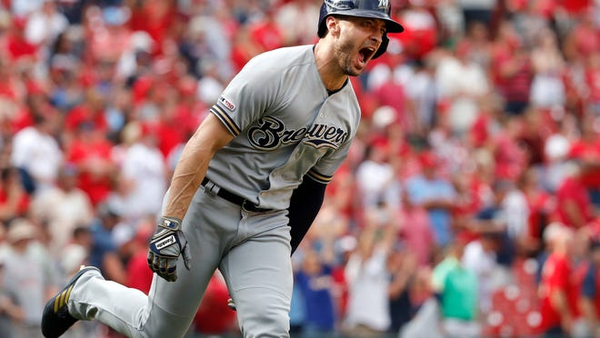 Milwaukee Brewers' Ryan Braun celebrates hitting a grand slam during the ninth inning of a baseball game against the St. Louis Cardinals Sunday, Sept. 15, 2019, in St. Louis. (AP Photo/Jeff Roberson)