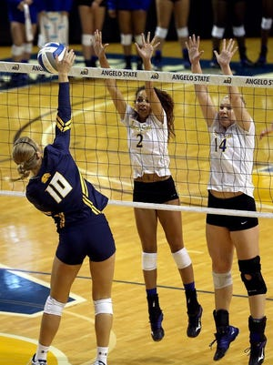 Angelo State's Morgan Seaton and Mallory Blauser try to block an attack earlier this year at the Junell Center, where the Rambelle are 14-0. ASU will host the Lone Star Conference Tournament this weekend.
