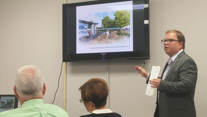 Richie Jones, a consultant with the Hodgson Douglas architecture and planning firm, gives a presentation to the Two Rivers Company board of directors on the Civic Plaza proposal.