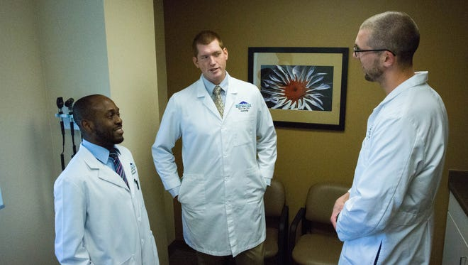 Ugonna Ezeh, left, Eric Czer, center, and Matthew Justus, right, all residents at MountainView Regional Medical Center. Tuesday, March 14, 2017