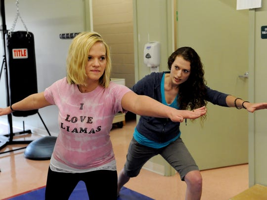 April McCurdy, assistant physical therapist, works with Stephanie Latier on her balance using yoga therapy at Genesis COOR. Stephanie spent nearly five weeks in Dodd Hall before moving out April 17 and beginning her outpatient rehabilitation sessions at Genesis.