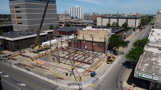 Construction has restarted on Marquette Savings Bank's new Operations, Training and Innovation Learning Center on the northwest corner of West 10th and Peach streets.