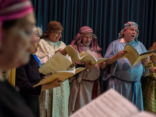 Members of the choir sing during rehearsal for Joseph