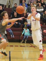 Seaholm guard Zach Ziegler makes a pass while attacking