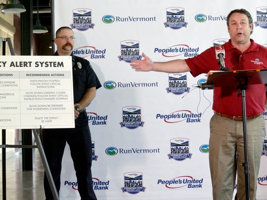 RunVermont Executive Director Peter Delaney, right, advises runners to take precautions for high temperatures during Sunday's People's United Bank Vermont City Marathon. He spoke at a news conference Thursday, May 26, 2016. At left is Ed Webster, a Burlington firefighter and EMT.