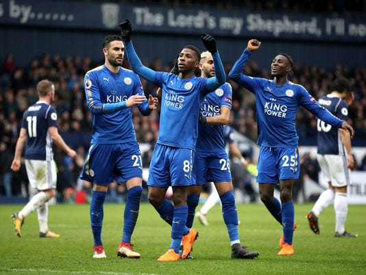 Leicester City's Kelechi Iheanacho, centre, celebrates scoring his side's third goal of the game against West Brom during their English Premier League soccer match at The Hawthorns in West Bromwich, England, Saturday March 10, 2018. (Nick Potts/PA via AP)