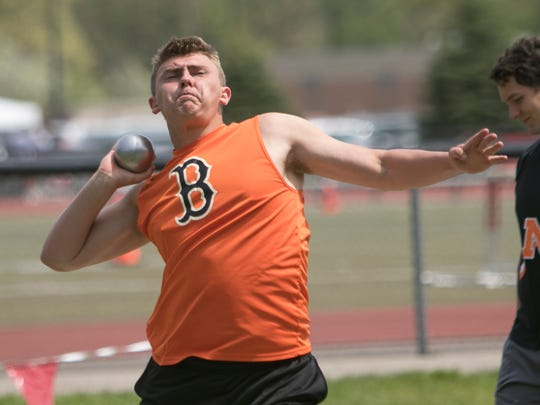 Dominic Valdes of Brighton warms up for the shot put