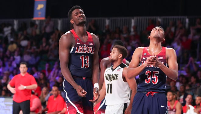 Nov 24, 2017;  Paradise Island, BAHAMAS; Arizona Wildcats forward Deandre Ayton (13) and guard Allonzo Trier (35) react during the first half against the Purdue Boilermakers in the 2017 Battle 4 Atlantis in Imperial Arena at the Atlantis Resort. Mandatory Credit: Kevin Jairaj-USA TODAY Sports