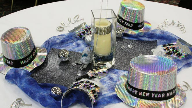 The tables are being decorated festively for the Soroptimist International of Yerington's New Year's Eve Ball tonight at the Pioneer Crossing convention center, one of many places locally to celebrate the arrival of the new year. The party starts at 7:30 p.m. and tickets are for sale at the door.