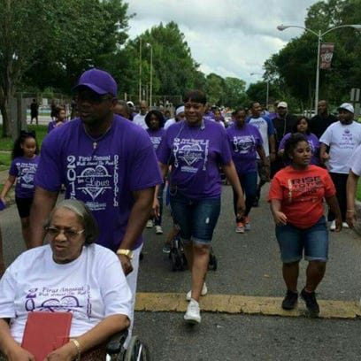 In this submitted photo,  walkers participate in the