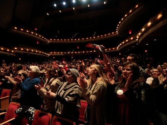 The audience stands an applauds Sen. Bernie Sanders