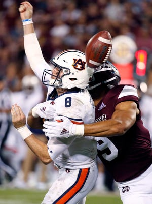 Mississippi State defensive end Montez Sweat (9) forces Auburn quarterback Jarrett Stidham (8) to fumble as he attempts to pass during the second half of MSU's 23-9 victory in Starkville Saturday.  (AP Photo/Rogelio V. Solis)