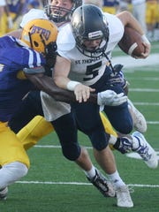 St. Thomas More's Jacque Lebas tries to get past Byrd's defense in the Battle on the Border Thursday evening at Independence Stadium.